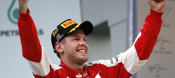 Ferrari driver Sebastian Vettel of Germany celebrates after winning the Malaysian Formula One Grand Prix at Sepang International Circuit in Sepang, Malaysia, Sunday, March 29, 2015. (AP Photo/Vincent Thian)
